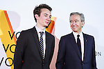 (L to R) Bernard Arnault Chairman and CEO of the luxury giant LVMH Moet Hennessy Louis Vuitton and his son Frederic Arnault pose for the cameras during the opening celebration for Louis Vuitton's ''Volez, Voguez, Voyagez'' exhibition on April 21, 2016, Tokyo, Japan. After a successful run in Paris, the luxury fashion brand now brings the instalment to Tokyo, which traces Louis Vuitton's history from 1854 to today. Some 1,000 objects, including rare trunks, photographs and handwritten client cards will be displayed. Japanese room will be set up specially for Japan, showcasing such rare items as makeup and tea ceremony trunks for kabuki actor Ebizo XI. The exhibition will be open to the public free of charge from April 23 to June 19. (Photo by Rodrigo Reyes Marin/AFLO)