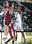 North Texas Mean Green forward George Odufuwa (4) and Texas State Bobcats forward Tony Bishop (22) go up for a rebound in the game between the Texas State Bobcats and the University of North Texas Mean Green at the North Texas Coliseum,the Super Pit, in Denton, Texas. UNT defeated Texas State 85 to 62