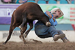 Cody Cabral competes in the steer wrestling event at the Reno Rodeo, in Reno, Nev. on Friday night, June 22, 2012..Photo by Cathleen Allison