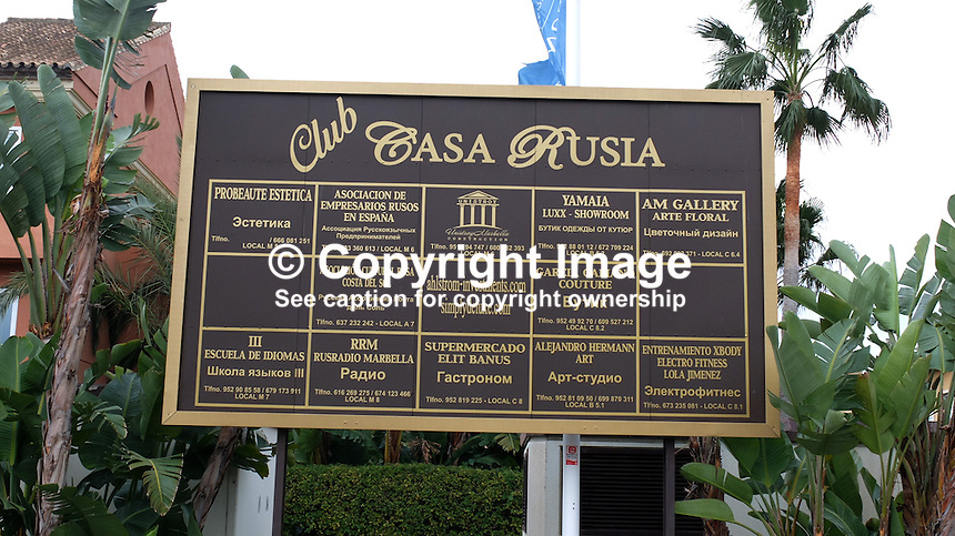 Signage in Russian on the Costa del Sol, Spain, shows its popularity with Russian ex-pats &amp; tourists. shopping plaza, list, businesses, February, 2015, 201502060432<br />