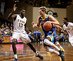 SIOUX FALLS, SD - NOVEMBER 26:  A.J. Hess #35 from South Dakota State University looks to drive past A.J. Merriweather #13 from East Tennessee State University during their game at the Sanford Pentagon Saturday evening in Sioux Falls. (Photo by Dave Eggen/Inertia)