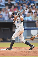 Charleston RiverDogs left fielder Michael O'Neill #10 swings at a pitch during a game against the Asheville Tourists at McCormick Field July 26, 2014 in Asheville, North Carolina. The RiverDogs defeated the Tourists 8-7. (Tony Farlow/Four Seam Images)
