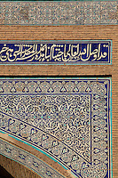 Detail of decoration of main facade of the Matniyaz Divan-begi Madrasah, 1871, Khiva, Uzbekistan, pictured on July 6, 2010, at sunrise. Commissioned by Muhammad Niyaz the rectangular, Madrasah has a traditional main facade, its high portal, decorated with majolica, having a central pentahedral niche and corner guldastas which are geometrically patterned in blue, white and green, with green brick domes. It currently houses a restaurant and the Khiva tourist agency. Khiva, ancient and remote, is the most intact Silk Road city. Ichan Kala, its old town, was the first site in Uzbekistan to become a World Heritage Site(1991). Picture by Manuel Cohen.