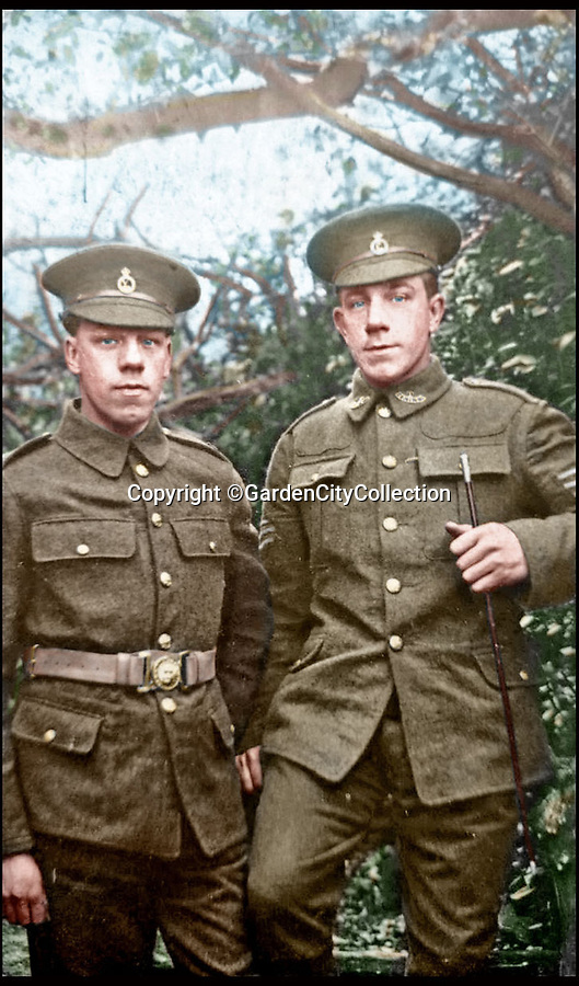BNPS.co.uk (01202 558833)<br /> Pic: GardenCityCollection/BNPS<br /> <br /> ***Please USe Full Byline***<br /> <br /> Jack and Walter Satterwaite pose for a photo in c.1914. Jack was kiled in action in April 1916, Walter was seriously wounded, dying as a result in 1962. <br /> <br /> Black and white photos of British Tommies preparing for the First World War have been brought to life after they were digitally colourised to mark the 100th anniversary of the start of the conflict.<br /> <br /> Some of the snaps show soldiers in vivid colour getting battle-ready at training camps in the Home Counties in July 1914.<br /> <br /> Others depict the men dressed in their smart green uniforms on parade in a market square on the eve of war and then stood on a train station platform as they head off for France.<br />  <br /> As well as being filled with colour, some of the photos are tinged with poignancy as many of the men pictured never came back.