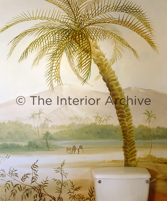 The toilet is situated in the shade of a painted palm tree in full view of passing elephants