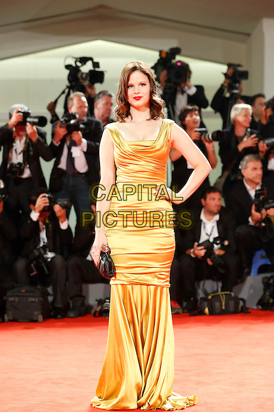 Rachel Korine.The 'Spring Breakers' Premiere during The 69th Venice Film Festival at the Palazzo del Cinema, Venice, Italy.September 5th, 2012 .full length gold sleeveless gold silk satin fishtail dress hand on hip black clutch bag.CAP/IPP/GR.©Gianluca Rona/IPP/Capital Pictures.