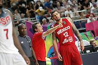 Mexico's coach Sergio Valdeolmillos with his player Hector Hernandez during 2014 FIBA Basketball World Cup Round of 16 match.September 6,2014.(ALTERPHOTOS/Acero)