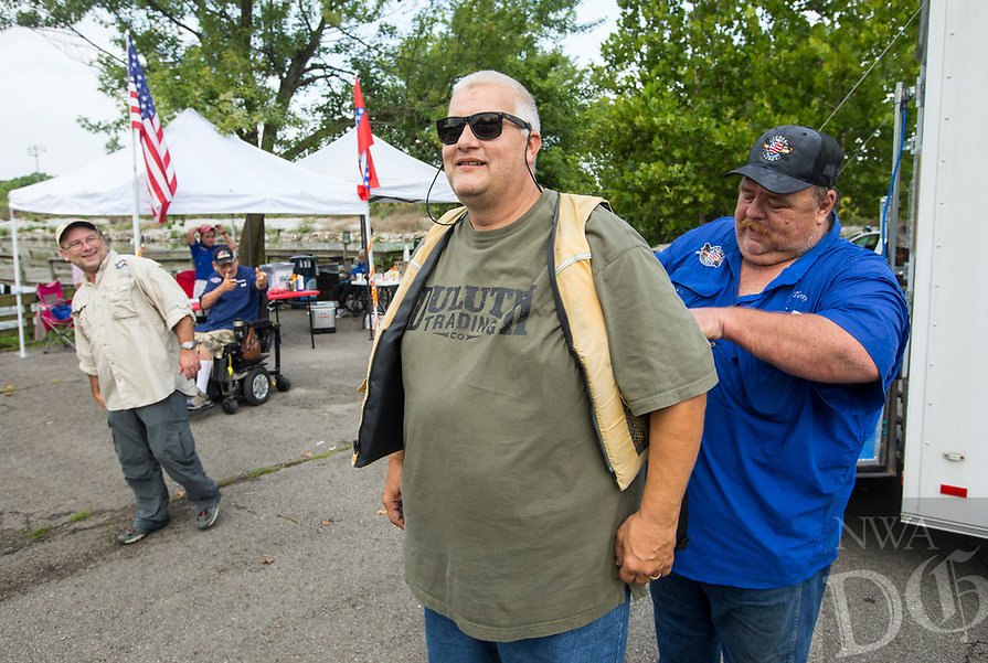NWA Democrat-Gazette/BEN GOFF @NWABENGOFF<br /> Terry Smith (right) of Springdale helps Wade Kamps, a veteran from Rogers get suited up in a personal flotation device before going out to fish in a kayak Saturday, Aug. 10, 2019, during the Heroes on the Water event at Lake Fayetteville.