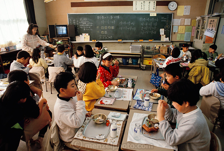 Lunchtime at nine-year-old Mio Ukita's classroom at school in Kodaira City, Japan. Material World Project. The Ukita family lives in a 1421 square foot wooden frame house in a suburb northwest of Tokyo called Kodaira City.