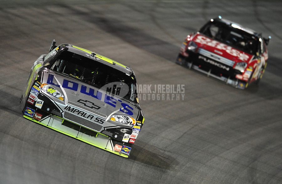 Nov. 16, 2008; Homestead, FL, USA; NASCAR Sprint Cup Series driver Jimmie Johnson (48) leads Carl Edwards (99) during the Ford 400 at Homestead Miami Speedway. Mandatory Credit: Mark J. Rebilas-