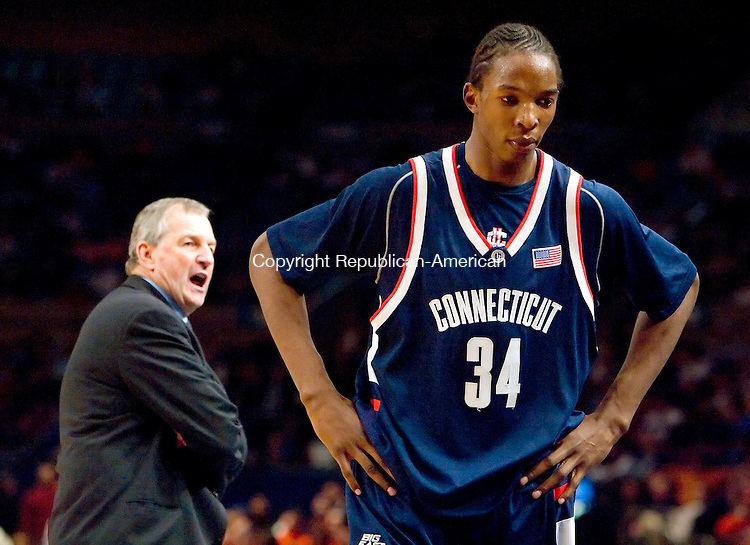 NEW YORK, NY--07 MARCH 2007--030707JS06-UConn Head Coach Jim Calhoun yells at Hasheem Thabeet as he makes his way to the bench during their 78-65 loss to Syracuse in the Big East tournament Wednesday at Madison Square Garden in New York City.<br /> Jim Shannon / Republican-American