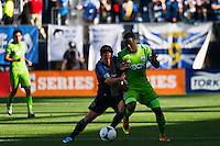 Daniel Cruz (44) of the Philadelphia Union battles Eddie Johnson (7) of the Seattle Sounders for the ball. The Philadelphia Union and the Seattle Sounders played to a 2-2 tie during a Major League Soccer (MLS) match at PPL Park in Chester, PA, on May 4, 2013.