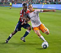 CARSON, CA – July 23, 2011: Chivas USA midfielder Michael Lahoud (11) and Houston Dynamo midfielder Brad Davis (11) during the match between Chivas USA and Houston Dynamo at the Home Depot Center in Carson, California. Final score Chivas USA 3, Houston Dynamo 0.