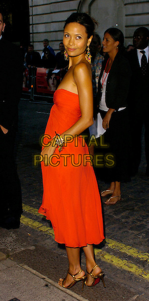 "THANDIE NEWTON.""Volver"" UK film premiere, Curzon Mayfair, London, UK..August 3rd, 2006.Ref: CAN.full length red strapless dress looking over shoulder.www.capitalpictures.com.sales@capitalpictures.com.©Can Nguyen/Capital Pictures"
