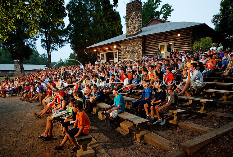 Camper watch the closing ceremonies at YMCA Camp Thunderbird, a Charlotte-area resident camp. YMCA resident Camp Thunderbird, operating since 1936, is one of several YMCA camps located in the Carolinas. The 100-acre camp is located about 20 minutes from downtown Charlotte, North Carolina.