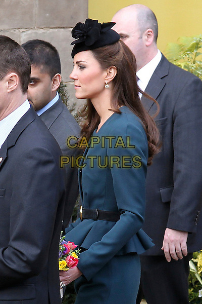 Catherine, Duchess of Cambridge (Kate Middleton).Accompanies the Royal family during  their visit to Leicester, on first date of Queen Elizabeth II's Diamond Jubilee tour of the UK, England, UK, .March 8th 2012..half length security LK bennett peplum jacket dress side teal  princess black hat green flowers side profile 3/4 .CAP/HIL.©John Hillcoat/Capital Pictures.