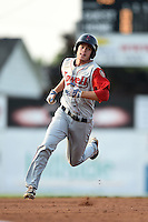 Lowell Spinners outfielder Mike Meyers (15) running the bases after hitting a triple during a game against the Batavia Muckdogs on July 18, 2014 at Dwyer Stadium in Batavia, New York.  Lowell defeated Batavia 11-2.  (Mike Janes/Four Seam Images)