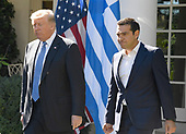 United States President Donald J. Trump and Prime Minister Alexis Tsipras of Greece arrive to hold a joint press conference in the Rose Garden of the White House in Washington, DC on Tuesday, October 17, 2017.<br /> Credit: Ron Sachs / CNP