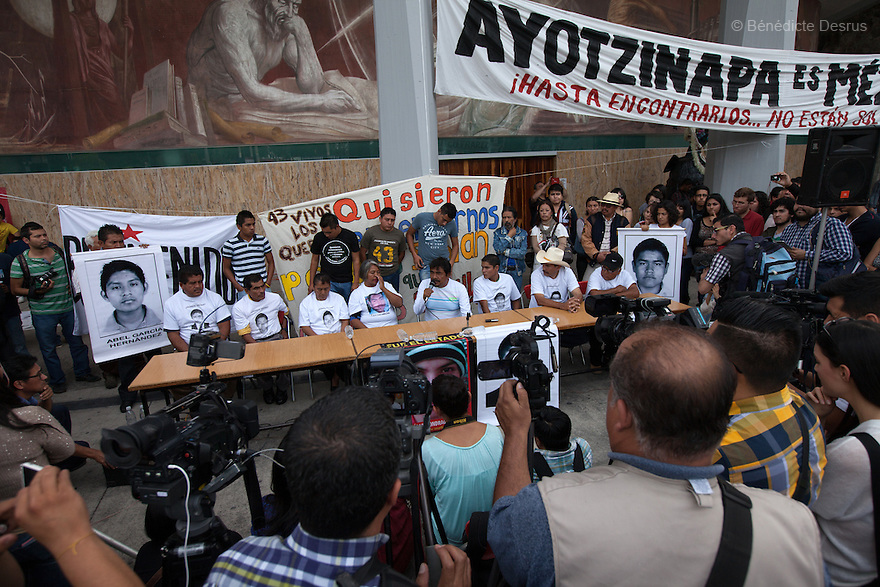 Felipe de la Cruz Sandoval (C), the spokesman for theparents, and parents of the 43 missing students from Ayotzinapa's teacher training college during a press conference at the University Center for Social Sciences and Humanities in Guadalajara, Jalisco, Mexico on November 18, 2014. The parents and relatives of the 43 missing students still do not believe the official line that the young men are all dead, and with classmates, social organizations and human rights defenders, they started on Thursday a national caravan. They split up into three different caravans, branching out to share information face to face with supporters in other cities and rally nationwide support. The three groups will meet in Mexico City on Thursday 20 for a general strike and massive marches to demand justice and fight against corrupted government and organized crime. Criticism of the government has intensified in Mexico, and many are demanding that the search for the 43 missing students continue until there is concrete evidence to the contrary. (Photo by BénédicteDesrus)