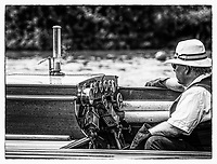 Henley. Berks, United Kingdom. 17th June 2017, Steam Launch, &quot;Consulta&quot; &quot;The Stoker/Engineer,&quot; keeps an eye on the Dials, during a race at the 2017 Henley' Women's Regatta. Rowing on, Henley Reach. River Thames. <br /> <br /> <br /> &quot;Film Noir Style Photography&quot;, &copy; Peter SPURRIER