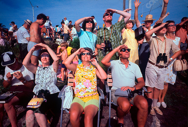 Launch of Apollo 11, first manned exploration of the moon. Spectators gather along the beach across from the launch pad  at The Kennedy Space Center to watch the lift off that morning. Titusvill, Florida, USA, July 16, 1969.