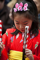 "Chakkirako is a folk dance that blesses the harvest and prosperity of the townspeople for the new year.  The chakkirako festival in Misaki is a traditional event held in Miura City. Girls aged 5 to 12 perform dances to music holding bamboo sticks ""chakkirako"" and fans. There is no established theory for the origin of Chakkirako, but it has been performed as a prayer for good catches of fish since the Edo period.  In 2010 Chakkirako was added to the list of Intangible Cultural Heritage in UNESCO.."