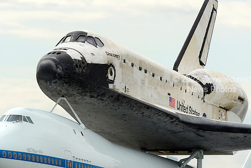 Space Shuttle Discovery sits atop its transport plane at Washington Dulles International Airport in Virginia after its final flight from the Kennedy Space Center in Florida on Tuesday, April 17, 2012.  Discovery will be on permanent display at the  Smithsonian Institution's Steven F. Udvar-Hazy Center in Chantilly, Virginia..Credit: Ron Sachs / CNP.(RESTRICTION: NO New York or New Jersey Newspapers or newspapers within a 75 mile radius of New York City)
