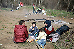 A picture taken on March 1, 2020. Refugees sit in a field near the Pazarkule gate in Edirne region, at the Turkish-Greek border. Migrants and refugees hoping to enter Greece from Turkey appeared to be fanning out across a broader swathe of the roughly 200-kilometer-long land border, maintaining pressure on the frontier after Ankara declared its borders with the European Union open. Photo by Hosam Salem