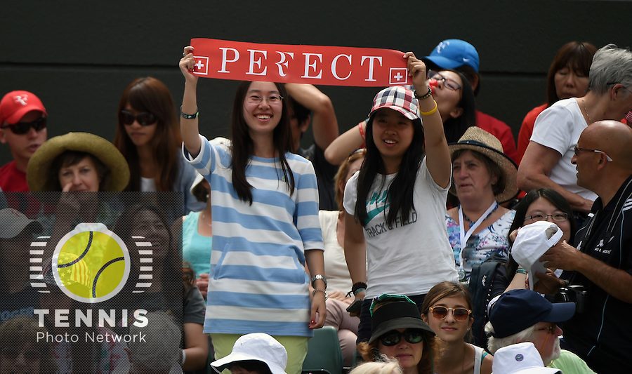 Wimbledon, 24/6/2014<br /> <br /> Swiss fans.<br /> <br /> Photo © Ray Giubilo