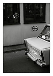 Boredom as a Trabant passes at the British checkpoint at Checkpoint Charlie, West Berlin, November 1989. Photograph copyright Graham Harrison.