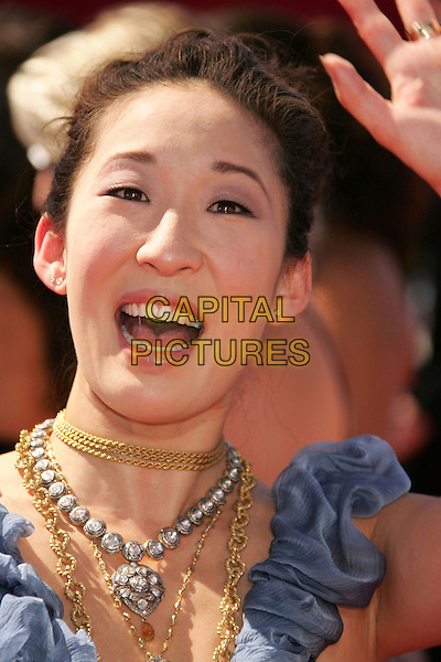 SANDRA OH.58th Annual Primetime Emmy Awards held at the Shrine Auditorium, Los Angeles, California, USA..August 27th, 2006.Ref: ADM/RE.headshot portrait ruffles blue necklaces gold silver.www.capitalpictures.com.sales@capitalpictures.com.©Russ Elliot/AdMedia/Capital Pictures.