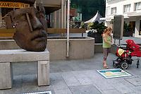 "Liechtenstein  Vaduz  June 2008.A ""African King""   bronze  of Gunther Stilling  in Stadtle street  ."