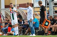 HAREN - Voetbal, FC Groningen - SM Caen, voorbereiding seizoen 2018-2019, 04-08-2018,FC Groningen trainer Danny Buijs geeft aanwijzingen aan FC Groningen speler Django Warmerdam