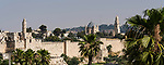 The city wall of Jerusalem with the minaret of the Tower of David or the Citadel in the foreground.  Behind is the bell tower and church of the Dormition Abbey on Mount Zion, outside the walls.  The Old City of Jerusalem and its Walls is a UNESCO World Heritage Site.