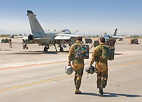 Pilots from the Italian Air Force (Aeronautica Militare) walk on the tarmac to their jets to take part in Green Flag excercises at Nellis Air Force Base in Las Vegas, NV.