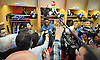 A scrum of media gathers around New York Giants No. 90 Jason Pierre-Paul inside the locker room of Quest Diagnostics Training Center in East Rutherford, NJ on Monday, Nov. 16, 2015.<br /> <br /> James Escher