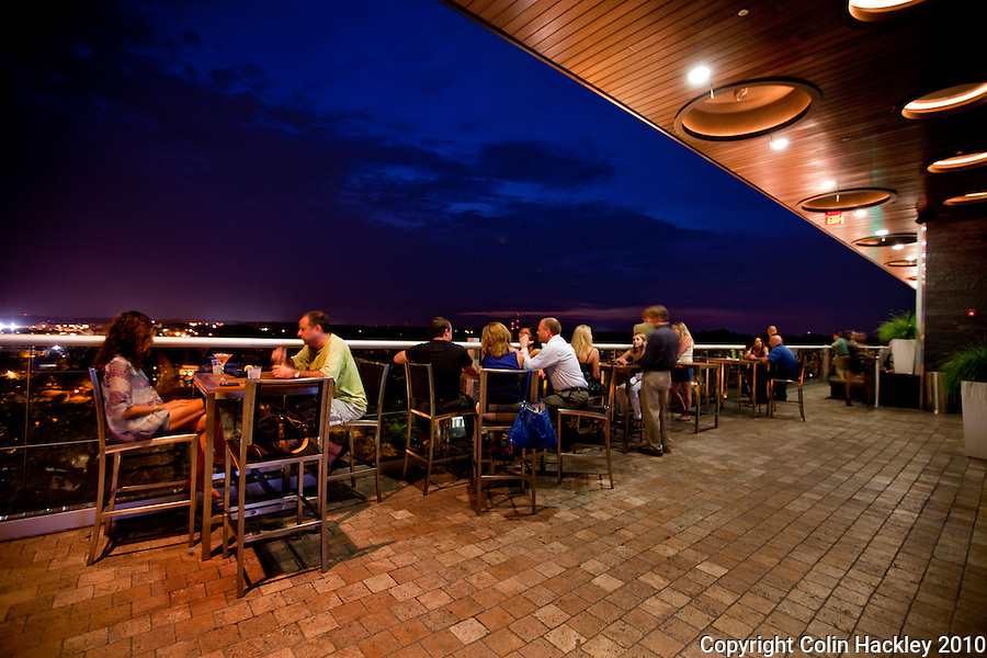 TALLAHASSEE, FLA. 8/21/10-VISITTALLY-082110-HACKLEY-Patrons enjoy the end of the day at the Level 8 bar atop the Hotel Duval in Tallahassee...COLIN HACKLEY PHOTO