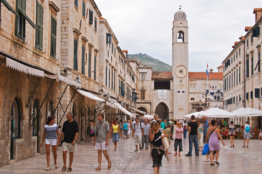 The main street Stradun Placa with traditional houses and flocks of tourists, view over clock tower on the central square Dubrovnik, old city. Dalmatian Coast, Croatia, Europe.