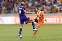 Houston, TX - Friday May 20, 2016: Morgan Brian (6) of the Houston Dash and Becky Edwards (14) of the Orlando Pride. The Orlando Pride defeated the Houston Dash 1-0 during a regular season National Women's Soccer League (NWSL) match at BBVA Compass Stadium.