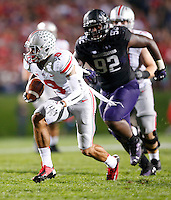 Ohio State Buckeyes wide receiver Devin Smith (9) is pursued by Northwestern Wildcats defensive lineman Will Hampton (92) during Saturday's NCAA Division I football game at Ryan Field in Evanston on October 5 2013. (Barbara J. Perenic/The Columbus Dispatch)