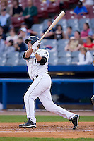 Eddy Martinez-Esteve (8) of the Connecticut Defenders follows through on his swing versus the Trenton Thunder at Dodd Stadium in Norwich, CT, Tuesday, June 3, 2008.