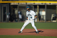 Eric Brown (20) of the Coastal Carolina Chanticleers takes his lead off of second base against the Illinois Fighting Illini at Springs Brooks Stadium on February 22, 2020 in Conway, South Carolina. The Fighting Illini defeated the Chanticleers 5-2. (Brian Westerholt/Four Seam Images)