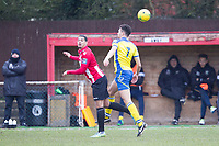 Leon McKenzie of AFC Hornchurch nods on under pressure from Lionel Stone (Haringey Borough) during AFC Hornchurch vs Haringey Borough, Bostik League Division 1 North Football at Hornchurch Stadium on 10th February 2018