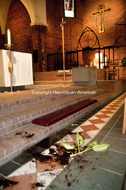 TORRINGTON, CT, 04  JUNE 15 - A vandal struck at St. Francis Church Thursday morning, toppling candles and statutes and breaking a potted plant on the altar. Police said he also set off a fire extinguisher and pulled a fire alarm before fleeing. He was later caught, and arrested.    Alec Johnson/ Republican-American