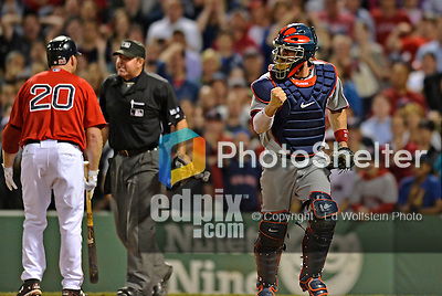 8 June 2012: Washington Nationals pitcher Jesus Flores pumps his fist after Stephen Strasburg strikes out Kevin Youkilis (arguing the call) during play against the Boston Red Sox at Fenway Park in Boston, MA. Youkilis was tossed as the Nationals defeated the Red Sox 7-4 in the opening game of their 3-game series. Mandatory Credit: Ed Wolfstein Photo