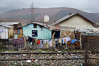 Houses in Cesmin lug IDP camp in northern Mitrovica that was built next to railway tracks. Houses are assembled together from different materials.
