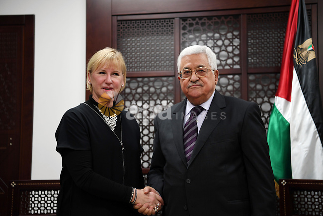 Palestinian president Mahmoud Abbas shake hands with Swedish Foreign Minister Margot Wallström during a meeting in the West Bank city of Ramallah on December 15, 2016. Photo by Thaer Ganaim