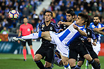Unai Bustinza of Club Deportivo Leganes competes for the ball with Lucas Vazquez and Alvaro Morata of Real Madrid during the match of  La Liga between Club Deportivo Leganes and Real Madrid at Butarque Stadium  in Leganes, Spain. April 05, 2017. (ALTERPHOTOS / Rodrigo Jimenez)
