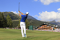 Lucas Bjerregaard (DEN) plays his 2nd shot on the 18th hole during Sunday's Final Round 4 of the 2018 Omega European Masters, held at the Golf Club Crans-Sur-Sierre, Crans Montana, Switzerland. 9th September 2018.<br /> Picture: Eoin Clarke | Golffile<br /> <br /> <br /> All photos usage must carry mandatory copyright credit (&copy; Golffile | Eoin Clarke)