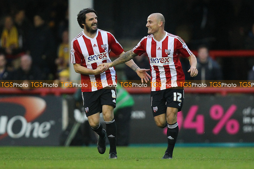 Alan McCormack of Brentford (12) celebrates scoring the first goal for his team from the penalty spot with Jonathan Douglas - Brentford vs Staines Town - FA Challenge Cup 1st Round Proper Round Football at Griffin Park, London - 09/11/13 - MANDATORY CREDIT: Gavin Ellis/TGSPHOTO - Self billing applies where appropriate - 0845 094 6026 - contact@tgsphoto.co.uk - NO UNPAID USE